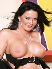 Dark haired office lady Maya Devine is showing her milf titties on camera
