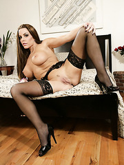 Pretty woman Victoria Valentina posing in stockings and showing pussy