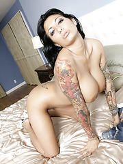 Wet and pleased pornstar Ricki Raxxx spreading pussy on a comfy bed