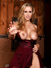 Entrancing milf Julia Ann showing big tits and playing with her snatch