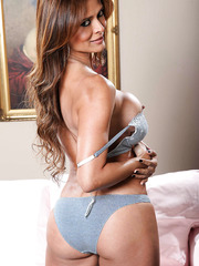 Snazzy milf Monique Fuentes posing in blue panties and getting dirty