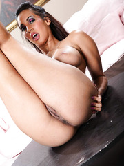 Alluring pornstar Isis Love prefers to show big tits and masturbates a little