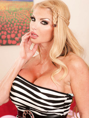 Lovely mom Taylor Wane prefers to pose in hot lingerie and masturbate