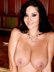 Tall actress Ava Addams spreading wet pussy and masturbating in the kitchen