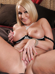 Magnificent blonde milf with sexy eyes Mellanie Monroe poses on the camera