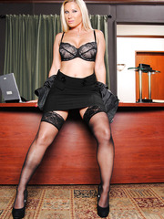 Blonde milf with flawless body Devon Lee strips on her work table