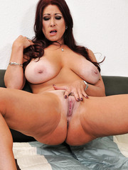 Amazing milf with big natural tits Tiffany Mynx gets naked and caresses pussy