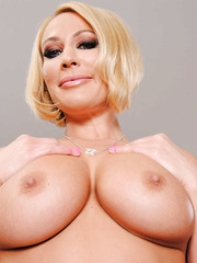 Ladylike blonde bombshell with big melons Mellanie Monroe poses naked
