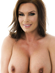 Busty bombshell with big tits and mesmerizing eyes Diamond Foxxx poses naked