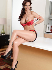 Elegant and beautiful redhead milf Syren De Mer in the hot striptease scene