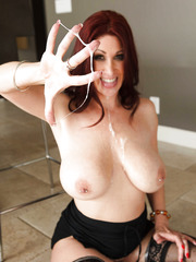 Busty redhead in sexy stockings Tiffany Mynx got a portion of thick semen