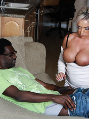 Sexy big titty pornstar Carmen Jay sucking huge black cock on sofa