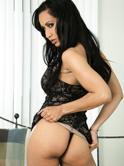 Isis Love is a horny brunette milf with slender body, big tits and long legs