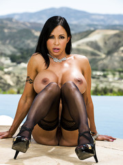 Incredibly hot busty brunette Jewels Jade with a hot tattoo poses outdoor