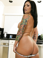 Fascinating brunette with saucy look, hot tattoos and big tits Mason Moore