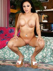 Bewitching black haired babe with big tits Audrey Bitoni takes off her skirt and lingerie
