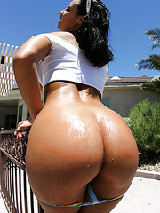 Curvy brunette babe Sandra Romain demonstrates her treasures outdoor