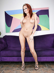 Redhead milf Monica Mayhem spreads legs and shows her shaved pussy