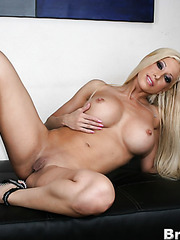 Young blonde babe Gina Lynn demonstrates her sexy body and a sweet pussy