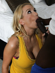 Blonde pornstar Blake Rose sucking huge black cock and ride on it