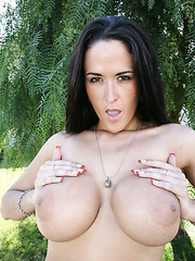 Beautiful and busty brunette milf Carmella Bing undresses just for you