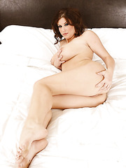 Appetizing milf Sara Stone takes off her lingerie and poses on the bed