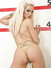Glamorous blonde bandit with fascinating eyes Delta White poses naked
