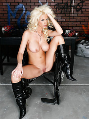Sexy blonde Tanya James takes off her latex uniform and poses naked