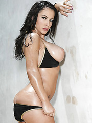 Extremely sexy bombshell with curvy lines Jenna Presley poses near the pool