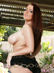 Bewitching hottie with big tits Sophie Dee presents her appetizing body