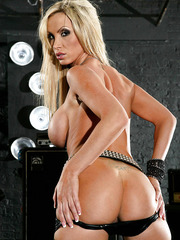 Busty and sweet rock & porn star babe Nikki Benz strips on the scene