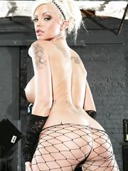 Charming blonde rock star Delta White presents her big tits and powerful ass