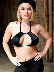 Sweet blonde babe Krissy Lynn and her delicious big tits in the striptease scene