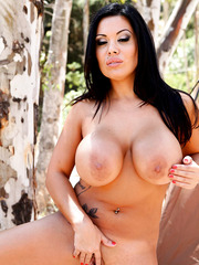 Fascinating and sexy black haired babe Sienna West teases with her perfect big breast