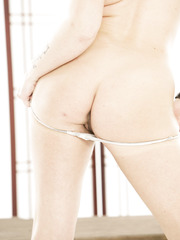 Pale skinned redhead girl Andy San Dimas masturbates with her naughty fingers