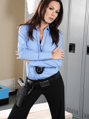 Hot sheriff Kirsten Price shows off her tits with a gun in the hands