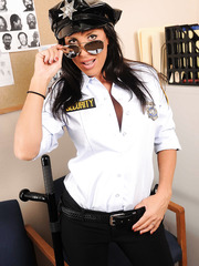 Busty milf Lezley Zen is the hottest security guard and she proves it in the office