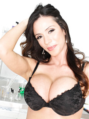 Brunette mistress Ariella Ferrera surprises us with her big round boobs in the laboratory