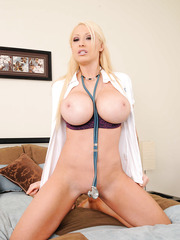 Blondie with fantastic large boobs Candy Manson peels off her gorgeous lingerie