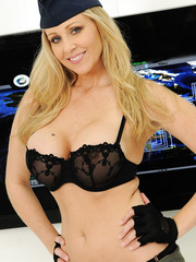 Astounding blonde milf Julia Ann willingly shows off her great boobs and alluring snatch