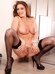 Appetizing redhead Roberta Gemma treats us with her giant boobs and sweet nipples