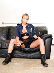 Sexy cop in deep blue uniform Mia Lelani spreads her incredibly flawless shaved pussy
