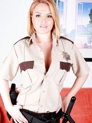 Hot sheriff Krissy Lynn willingly takes off her uniform and poses naked with her big tits