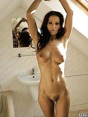 Beautiful and sexy brunette girl Angel Dark shows her gorgeous body and a pussy
