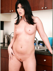 Attractive woman Taryn Thomas masturbating in kitchen and making a blowjob