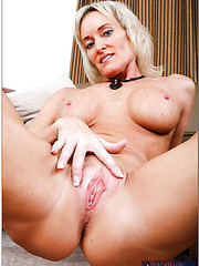 Pretty blonde milf KC Kelly getting naked and making a deep blowjob