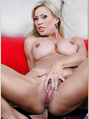 Seducing big tits milf Amber Lynn is sucking hard cock of her lover
