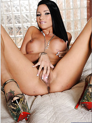 Dark haired milf Raven Bay is having her pussy licked out by Tory Lane