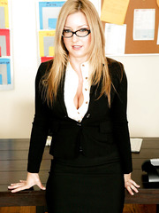 Blonde milf secretary Avy Scott is showing her big tits in office