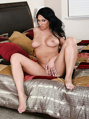 Beautiful brunette babe Kitty Bella in the inspiring bedroom striptease action
